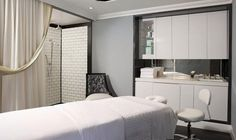 The Surrey Hotel -  The spacious bathrooms indulge the senses with white Carrera marble, Waterworks rain shower heads, Pratesi robes and custom-designed bath amenities by Laura Tonatto of Milan.