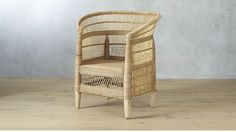""" Each chair takes 10 days to complete, handcrafted by Malawi artisans in collaboration with CB2 and non-profit organization People of the Sun"" woven malawi chair"