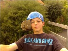 haha he took a soccer ball and cut it into a hat! oh louis!  Omg LOUIs!!!