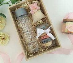 Loving this gift box with pastel French macarons and a mini muslin bag of goodies | voss water | client gift | thanks you gift | natural wood box | Barbona | pink and cream
