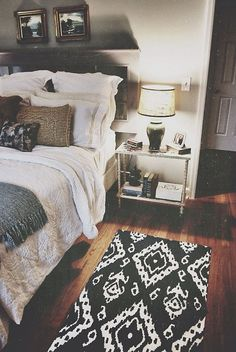 I like the contrast of the dark grey, white and the rough brown pillow. Good play on texture as well .