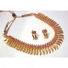 Buy Pink Stone Golden Zigzak Necklace Set Online at cheap prices from Shopkio.com: India`s best online shoping site