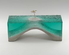 Laminated clear float glass with cast concrete base and cast white bronze palm tree. H 300 x W 550 x D 200mm. [SOLD]