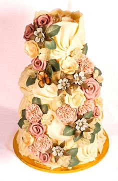 The Gatekeepers cake, three Belgian chocolate-coated tiers, detailed with vintage-pink roses, peonies, lisianthus, aquilegia, and gatekeeper butterfly