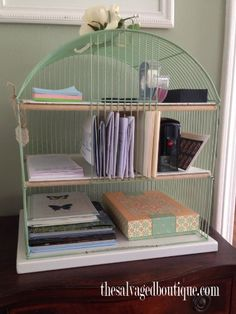 A birdcage's skinny slots are the perfect size for corralling important mail, and when spray-painted in a soft hue, the cage makes for delicate desk decor.