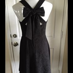 Jessica Simpson Bow Dress Fabulous sleeveless dress by Jessica Simpson, floral textured print, black on black, bow in back, fitted, NWT Jessica Simpson Dresses Midi