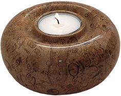Elegant round fossil stone candle holder measuring at 3.15 x 4.33 inches (5 x 11 cm).