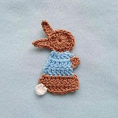 PATTERN ONLY for the super cute Peter Rabbit applique written in English with standard US terms. You must have decent crochet knowledge and know how to read a crochet pattern. This pattern is in a PDF format. You will receive an email from Etsy with download instructions once