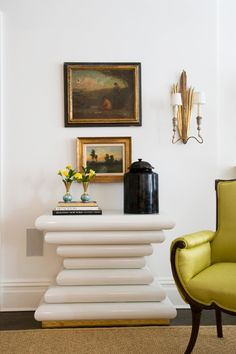 Melissa Miles Rufty, Modern console table mixed with classic oil paintings with a punch of color on the upholstery!  The modern console keeps things light and fresh.