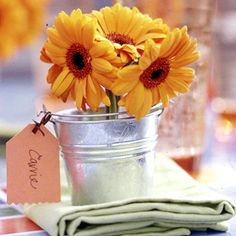 Gerbera Daisy Place Card - Fill buckets with fresh-cut flowers, or use silk flowers for a gift that will last. Cut a tag from card stock, pink one edge with pinking shears, and tie onto the bucket handle with ribbon or twine.
