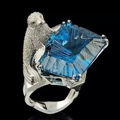 Don't know what the animal is on this piece, but he sure is holding a beautiful gem stone.