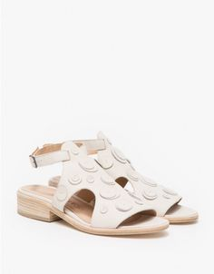 From Creatures of Comfort, a modern open toe sandal with elegant stitched geometric detailing. Features soft leather uppers, wraparound leather strap with buckle closure, cushioned footbed and short stacked heel.  • Open toe sandal with stitched geometr