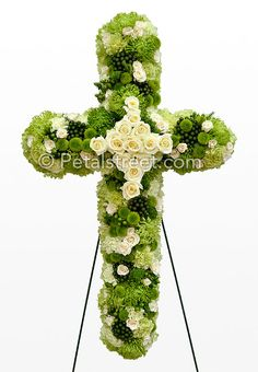 Irish Funeral Flower Cross form with green Hydrangea, Spider Mums, Button Mums, and Carnations, and white Roses.