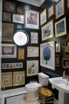 Guest Bathroom After - black walls, marble floors and an artwork gallery.
