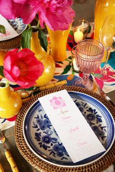 Table setting at fiesta with bold colors and pink flowers