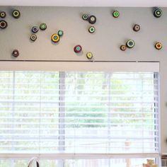 Another client photo showing how they chose to hang their slices 💚 #paintedtreerings #woodslice #wallart #interiordesign #roomdecor #abstractart #customart #modernart #natureinspired #treebranch #naturalelements #dimensions #nestsandburrows #eyecandy