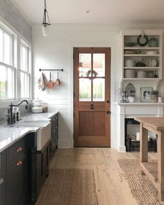rustic cottage kitchen design, modern farmhouse kitchen design with wood door and open shelf decor with black cabinets and marble counter with rustic island Cottage Kitchens, Home Kitchens, Farmhouse Kitchens, White Farmhouse, Modern Farmhouse, New Kitchen, Kitchen Decor, Kitchen Remodel, Sweet Home