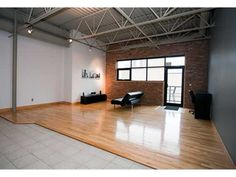 Downtown loft. Love the exposed brick. Bonus balcony space too.