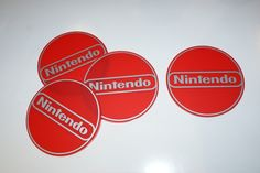 NINTENDO set of 4 Circle Coasters ..Matt Red Perspex with Matt Silver Graphics...£14.95 + Delivery... see www.mojo-shop.co.uk for more details