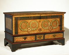 """Dower Chest for """"Henrich Neisz""""  Date / Circa """"1785""""  Attributed to John Bieber(1763-1825), Berks County,Pennsylvania  Pine and poplar retaining the original polychrome painted finish, iron strap hinges & escutcheon, and brass pulls.  Miscellaneous: Descended in the Rhoads family of Berks County, this chest came to us directly from a descendant of Heinrich Neiss. In the mid 19th century, the feet were removed and casters were added. The base molding and feet that"""