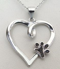 Your Paw Is On My Heart Necklace: Sterling Silver Heart with a dog paw print featuring black Cubic Zirconia crystals.