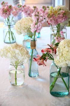 Simply Klassic Home: An Aqua & Pink Baptism  Use for your jars and bottles?  Simple colored flowers brought by your in-laws?
