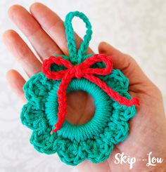 Whip up this crochet wreath ornament in minutes. These wreaths would also make great package toppers. Add a photo to the center to make it more special.