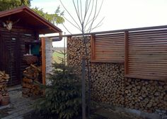 Fence design, fencing, slatted fence, gate, wood fence, firewood, landscape architecture, landscape design