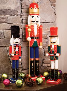 Nutcrackers guard the stockings by the fireplace #seasonal decor #decorations
