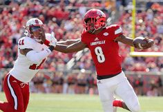LOUISVILLE, KY - OCTOBER 22: Lamar Jackson #8 of the Louisville Cardinals runs with the ball during the game against the North Carolina State Wolfpack at Papa John's Cardinal Stadium on October 22, 2016 in Louisville, Kentucky.  (3492×2424)