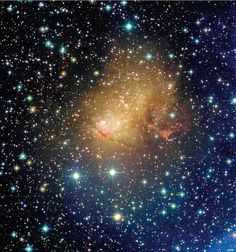 Giant blue stars ionizing hydrogen gas give dwarf galaxy IC 10 its signature blue glow and signal ongoing star formation. IC 10 is in our Local Group which is dominated by the Milky Way and Andromeda Galaxy. Credit: Canada-France-Hawaii Telescope/Coelum.