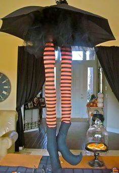 DIY - stuff stockings with polyfil (or pool noodle?) and hang from dollar store umbrella!