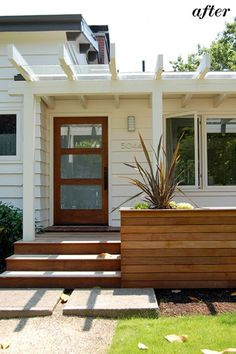 Reworked entry way with wood planters, new wood deck and steps, fresh coat of paint and new front door