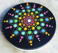 DIY: Mandala dotting stepping stone. On an earlier pin I made a stepping stone out of concrete and rubber cake molding. One side it has the little marbles put I didn't like so I turn it over and paint this.