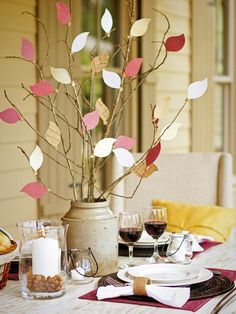 Take the kids for a stroll outdoors to gather bare branches to fill with colorful card-stock leaves for this easy #Thanksgiving centerpiece.