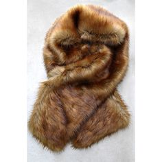 Get the Luxe Brown Faux Fur Stole ($54) ❤ liked on Polyvore featuring accessories, scarves, oblong scarves, faux fur scarves, brown scarves, faux fur stole and brown shawl