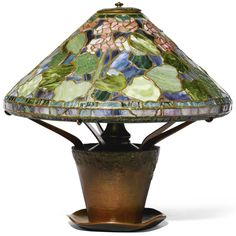 """** Tiffany Studios, New York, Favrile Leaded Glass and Patinated Bronze """"geranium"""" Lamp."""