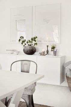 Floating white credenza; bright white interior; modern styling.