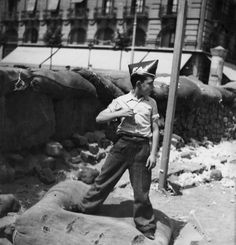 SPAIN. Spanish Civil war. Boy wearing cap of the FAI (Iberian Anarchist Federation), Barcelona, August 1936. Gerda Taro