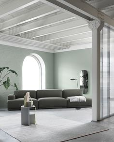 Living room interior inspiration with a clean green sofa: Our Connect Modular Sofa, seen here alongside the Leaf Floor Lamp, Halves Side Table and Ply Floor Rug. Home inspiration with Scandinavian design.