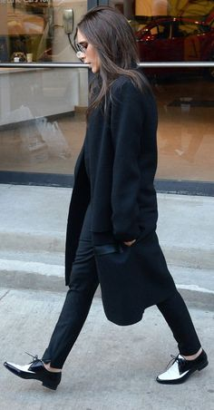 victoria beckham wearing flat shoes - ysl saint laurent black and white brogues - celebrity fashion - handbag.com