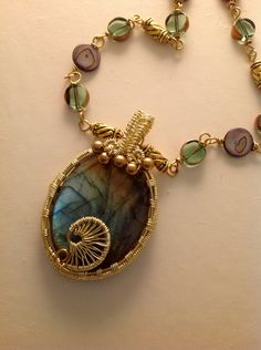 Rainbow Labradorite Wire Weaving Art Pendant with with Glass  and Pearl Bead Chain Necklace. $56.00, via Etsy.