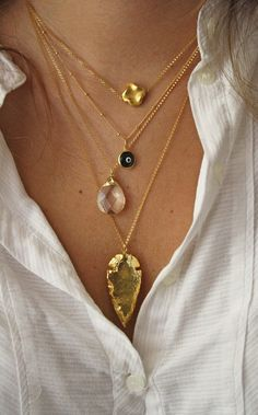 Wheretoget - Selection of pendant gold necklaces including an evil eye necklace