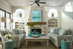 Tracery Interiors - living rooms - gray slipcovered sofas, salvaged wood coffee table, teal lattice stools, turquoise glass bottles, pebble ...