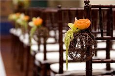 Natural twig or wire balls used as holders for fresh flowers on a aisle chair of a wedding. Beautiful and simple.