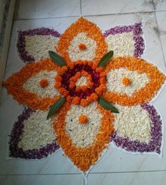 Pookalam designs are flower rangoli designs made using flower, flower petals and leaves.Pookalam rangoli designs are made during Onam, Diwali and Pongal. Rangoli Designs Flower, Rangoli Patterns, Colorful Rangoli Designs, Rangoli Ideas, Rangoli Designs Diwali, Diwali Rangoli, Flower Rangoli, Beautiful Rangoli Designs, Kolam Designs