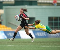 Canadian international Barbara Mervin running hard and getting past a tackler