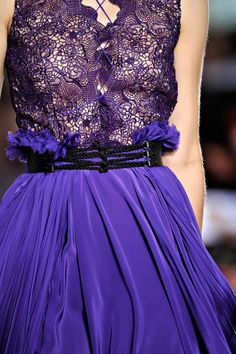 Purple skirt and lacy purple top.