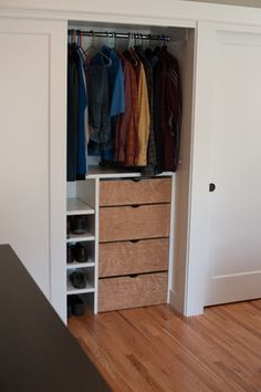 Small closet organization. Love for the hall closet. Those dumb shelves on top are too hard to reach!
