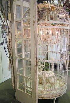 Blossoms Vintage Chic Big bird cage with chandlier in it. Love it!